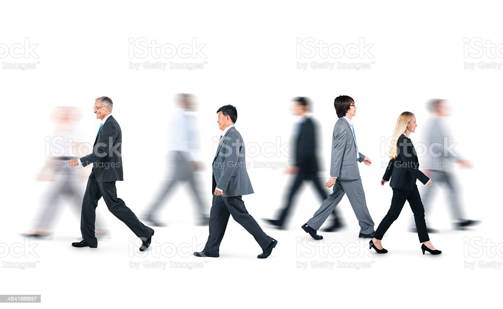 Group of Business People Walking in Different Directions stock photo