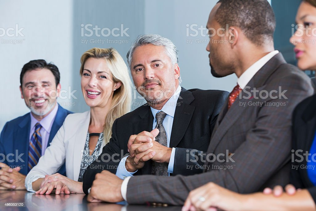 Group of business people watching presentation stock photo