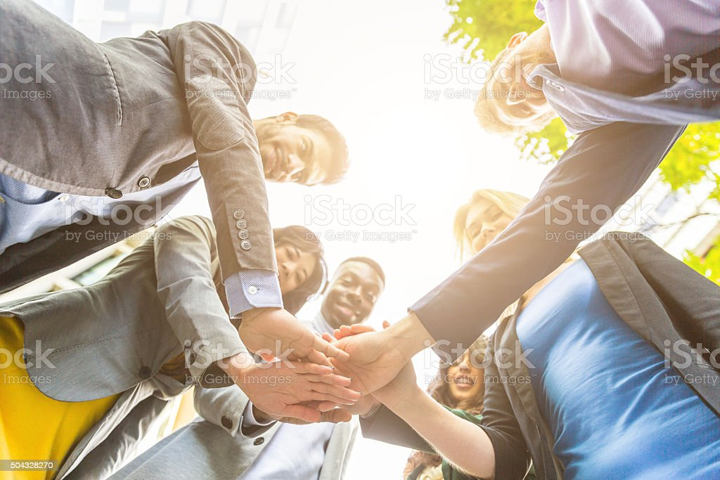 Group of business people with hands on stack stock photo