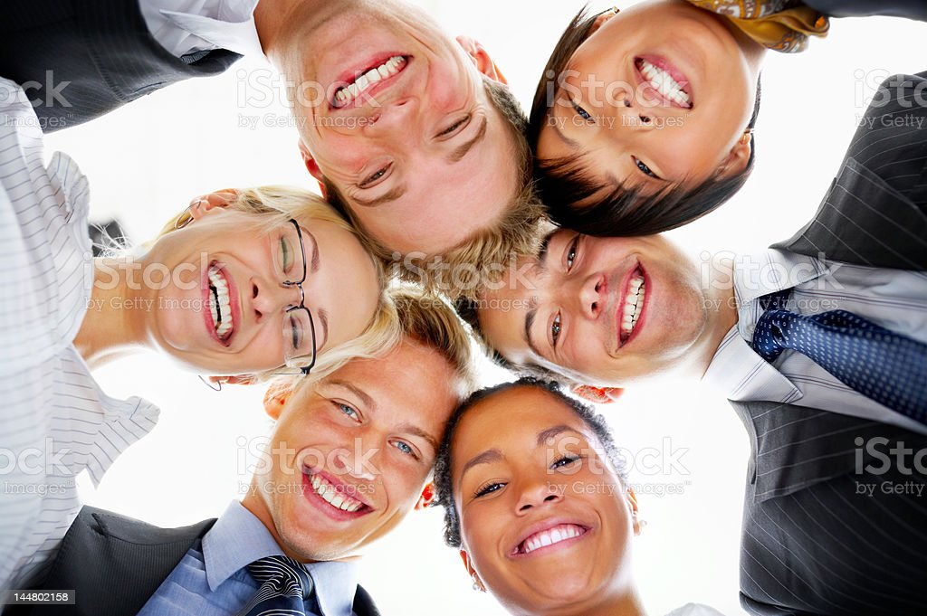 Group of business people with their heads together royalty-free stock photo