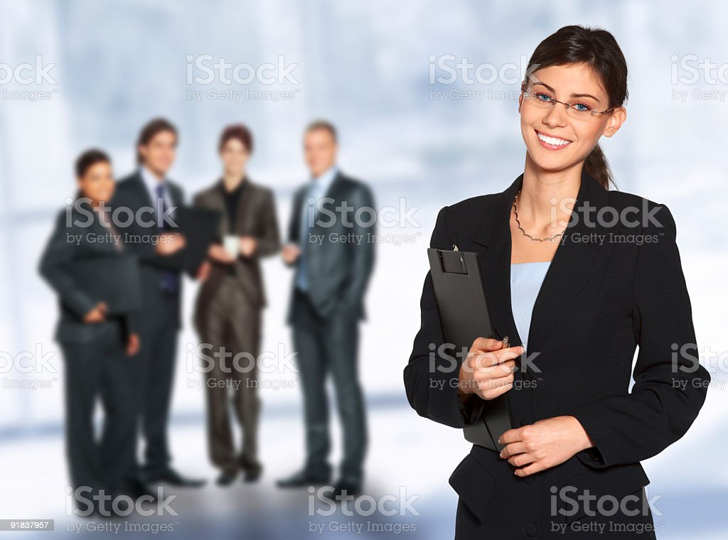 Group of business people with young woman in foreground stock photo