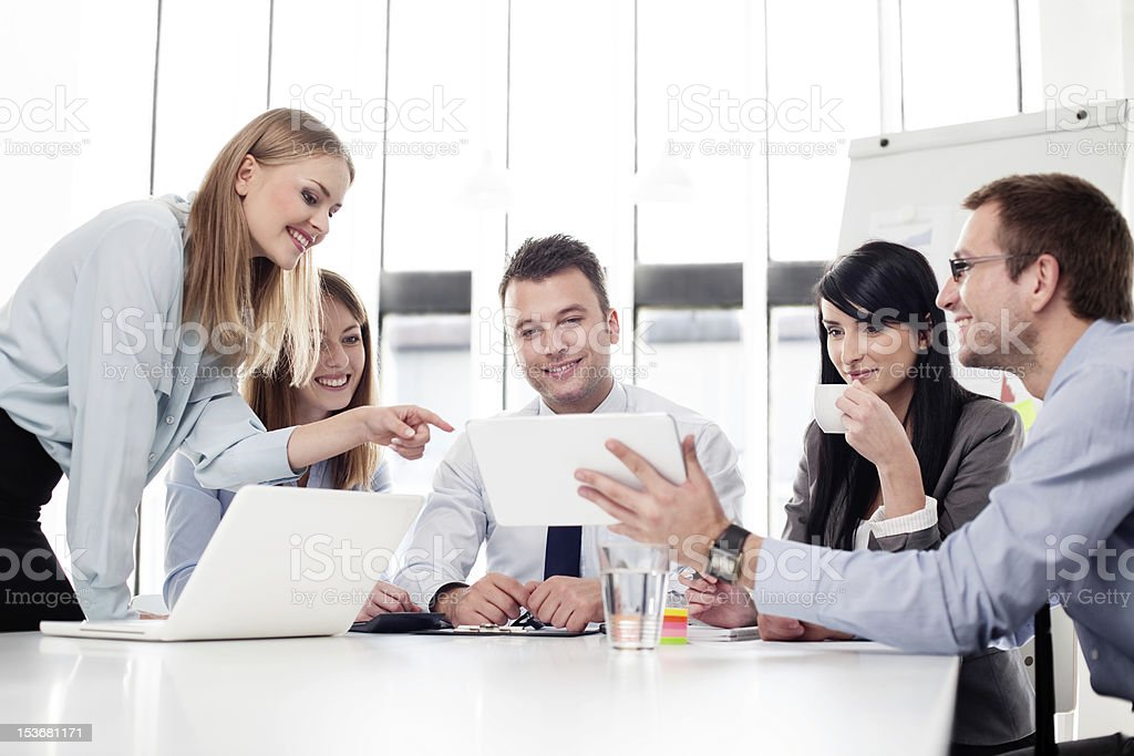 Group of business people working at office stock photo