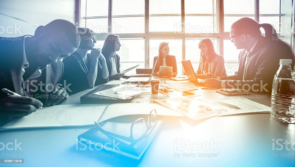 Group of business people working in the office stock photo