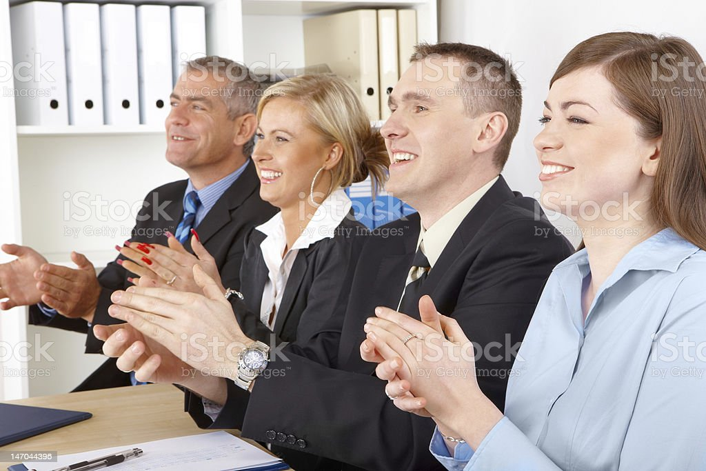 Group of business professionals clapping and smiling royalty-free stock photo