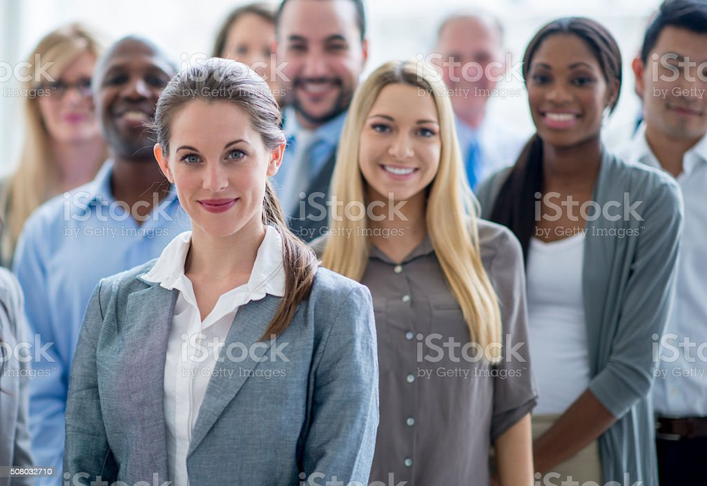 Group of Business Professionals Standing Happily stock photo