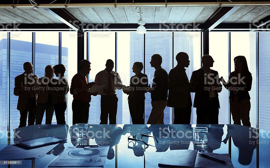 Grupo de negócios em uma reunião a falar - fotografia de stock
