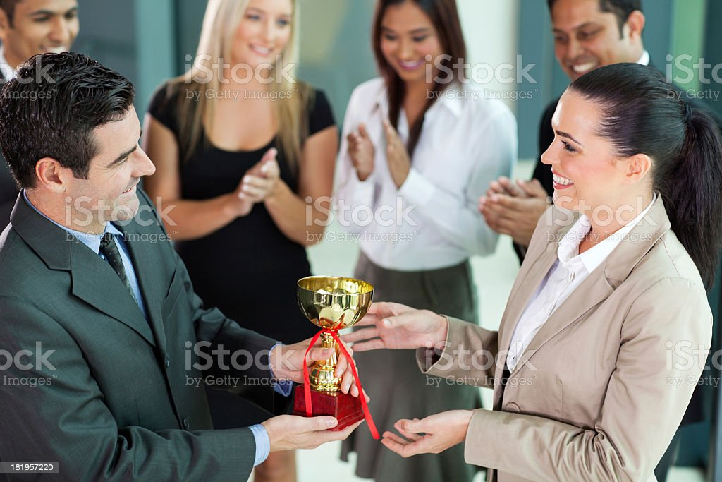 Group of business team winning a trophy stock photo