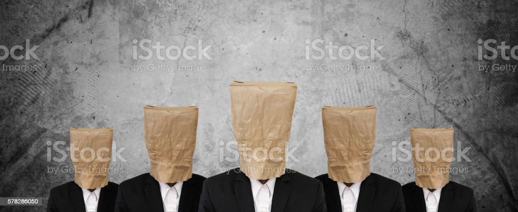 Group of businessman in suit with brown paper bag stock photo
