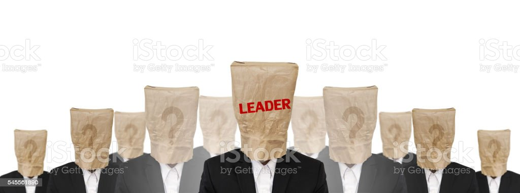 Group of businessman suit with brown paper bag, leadership concept stock photo