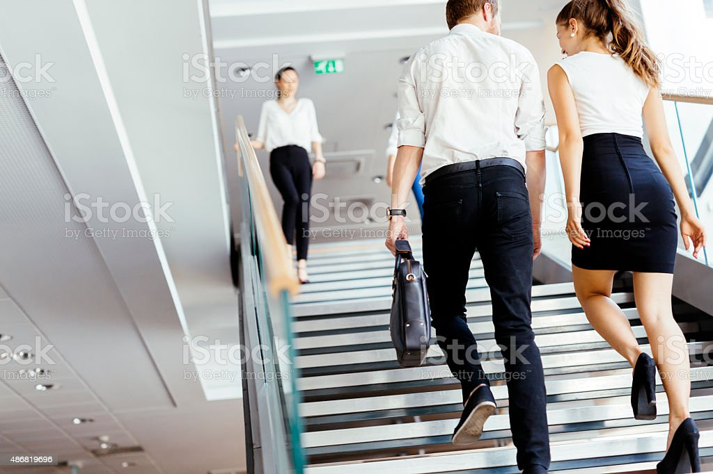 Group of businessman walking and taking stairs stock photo