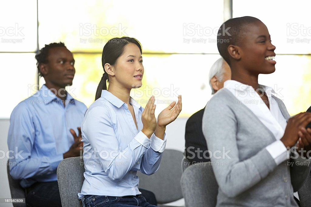 Group of businesspeople applauding a seminar stock photo