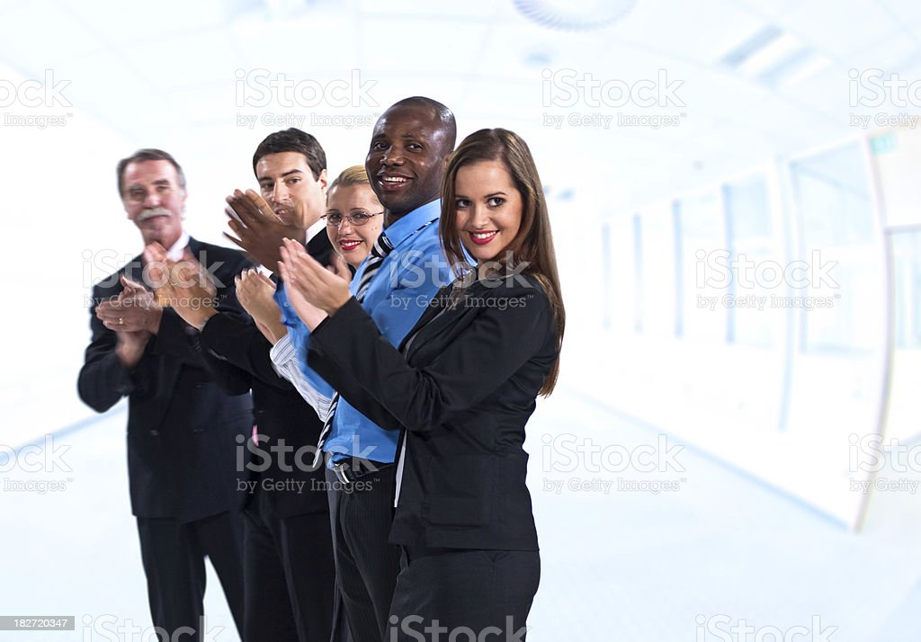 Group of businesspeople applauding royalty-free stock photo