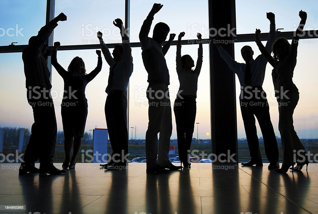 Group of businesspeople as silhouettes. royalty-free stock photo