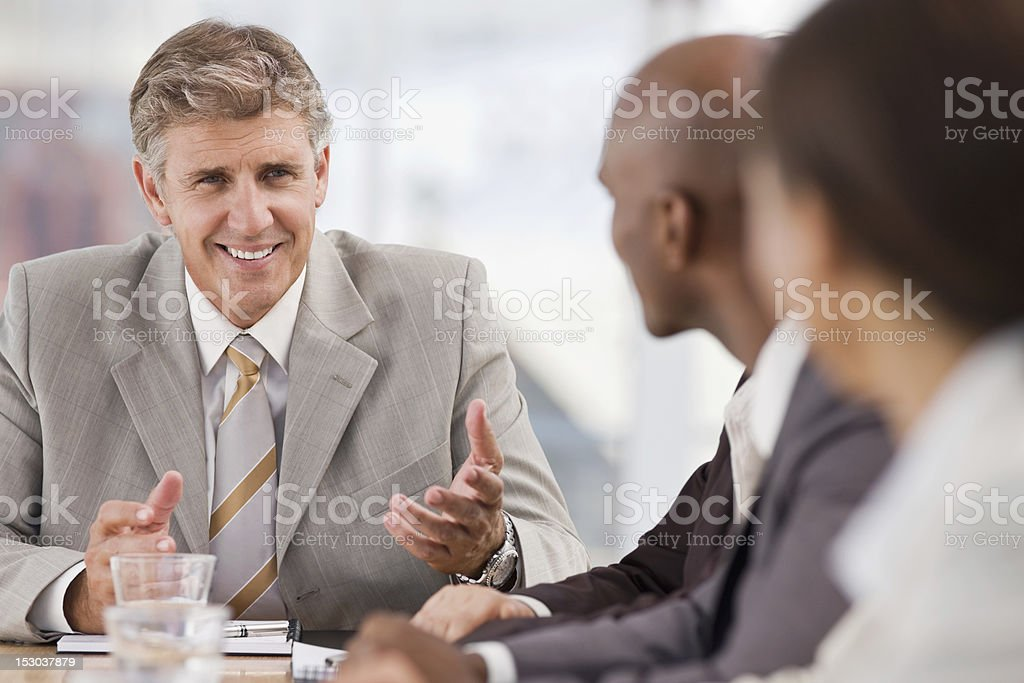 Group of businesspeople discussing at meeting royalty-free stock photo
