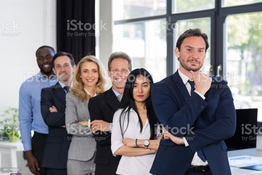 Group Of Businesspeople In Creative Office With Male Leader On...
