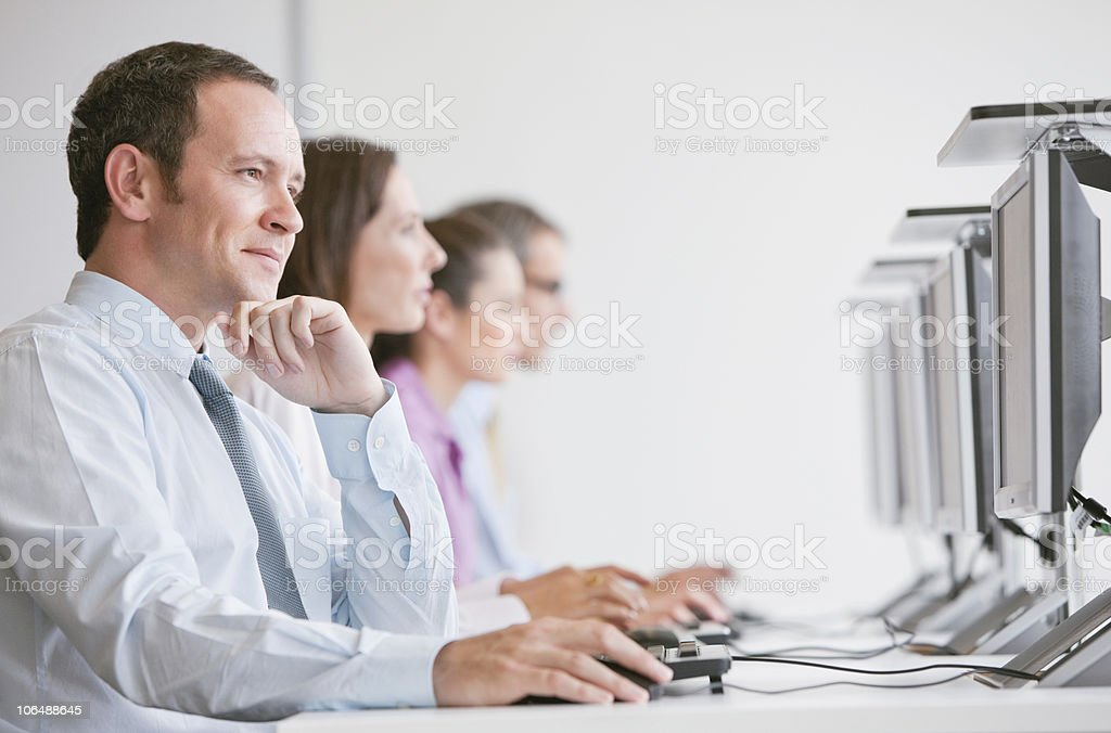 Group of businesspeople in row working on computer at office royalty-free stock photo