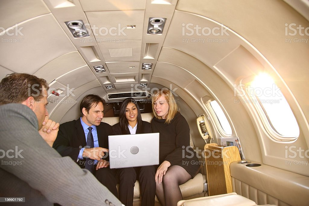Group of businesspeople meeting in private jet royalty-free stock photo