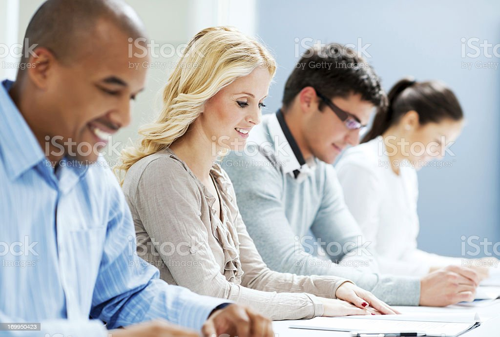 Group of businesspeople reading a documents. royalty-free stock photo