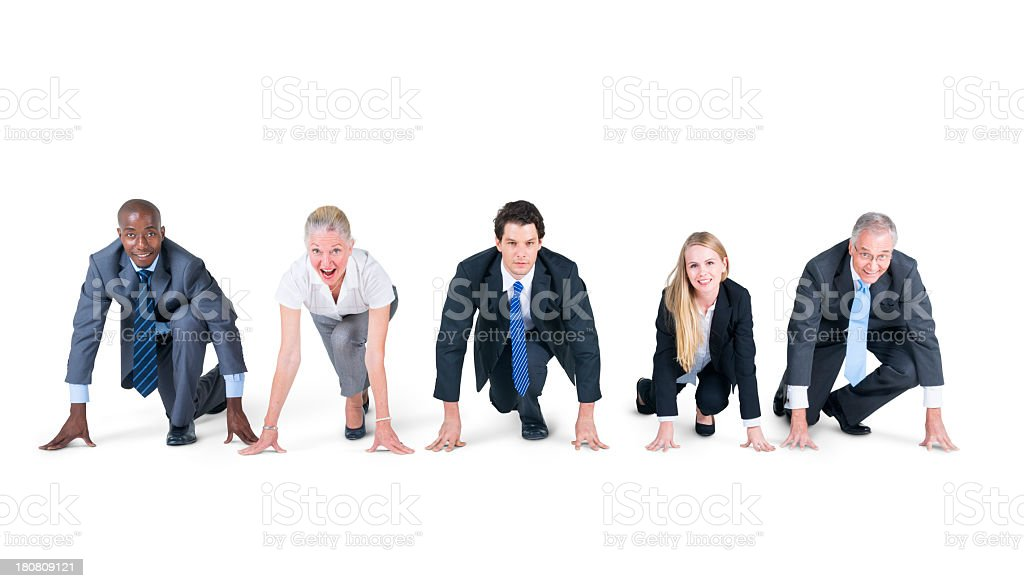 A group of businesspeople readying themselves for a race royalty-free stock photo