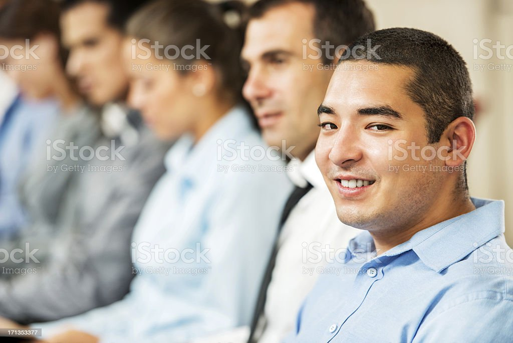 Group of businesspeople sitting in a line. royalty-free stock photo