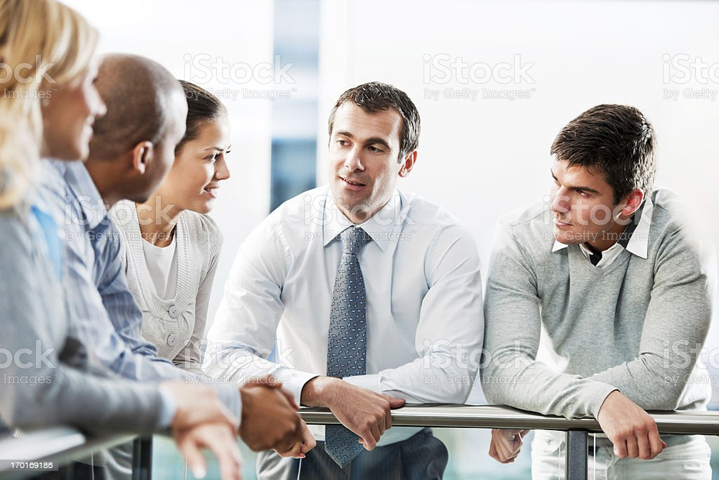 Group of businesspeople talking in a lobby. royalty-free stock photo
