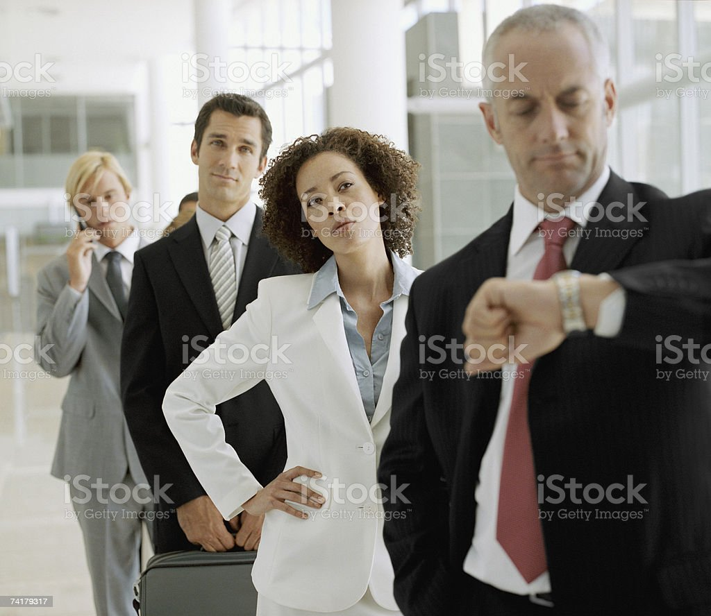 Group of businesspeople waiting in line stock photo