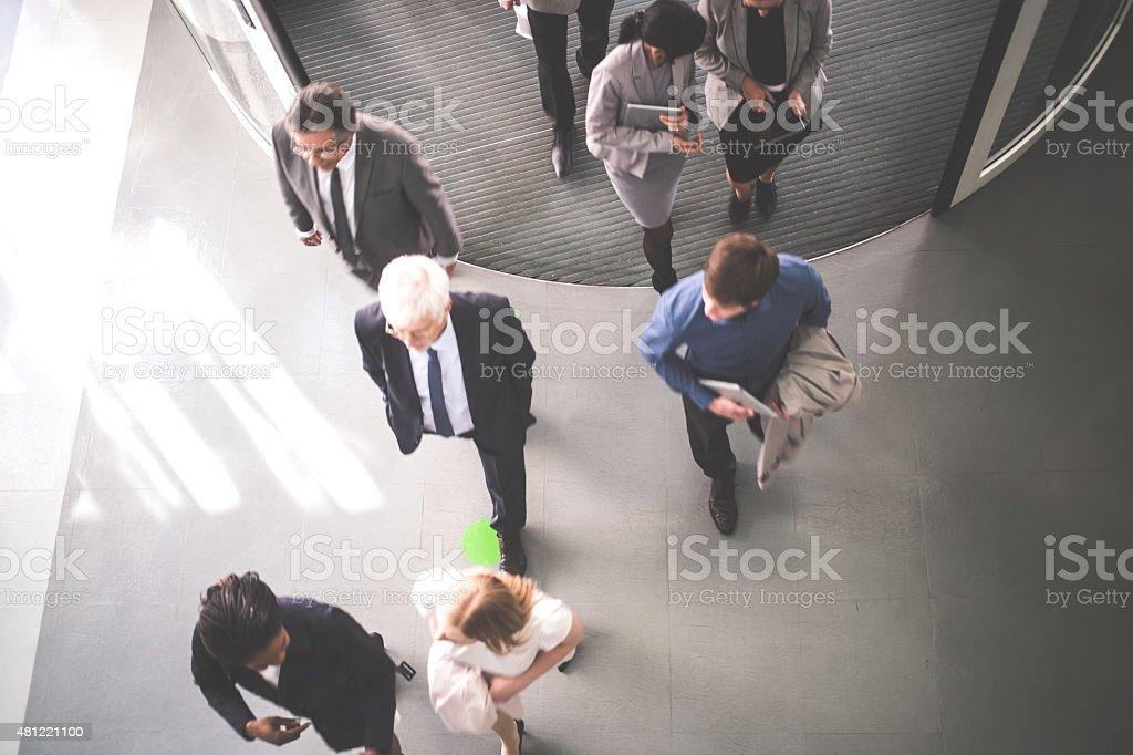 Group of  businesspeople walking stock photo