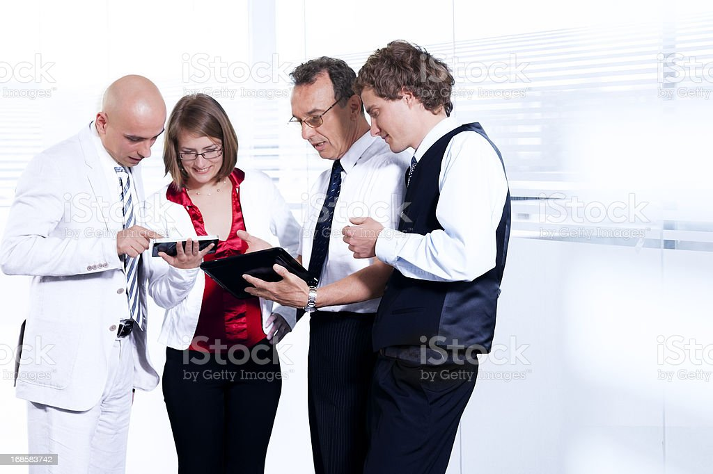 Group of  businesspeople with digital tablet royalty-free stock photo