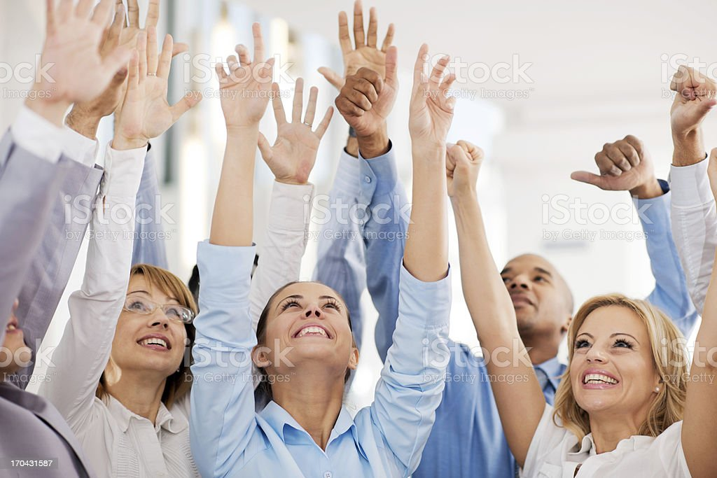 Group of businesspeople with raised hands. royalty-free stock photo