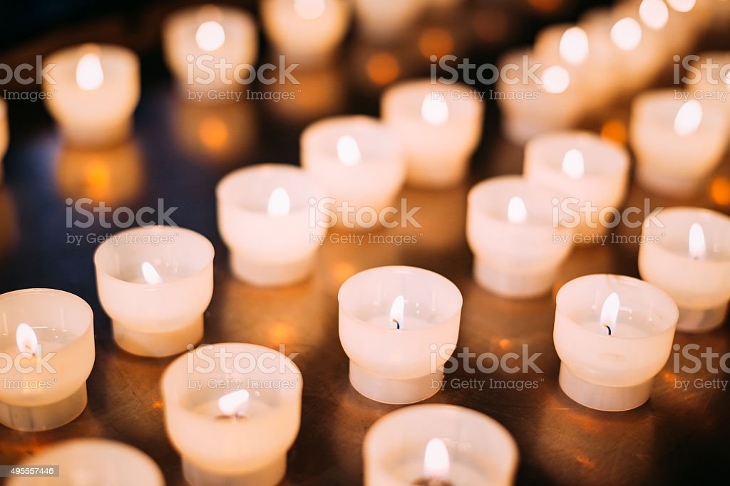 Group Of Candles In Church. Candles Light Background stock photo