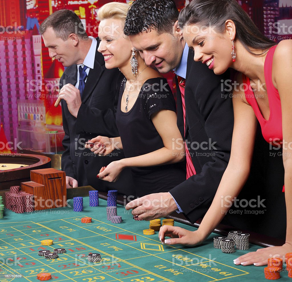 Group of casino gamblers on the roulette. stock photo