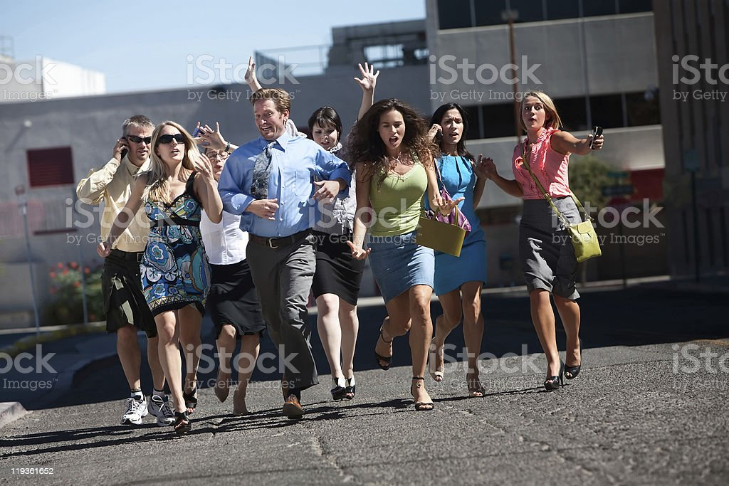 Group of casual business workers running on pavement royalty-free stock photo