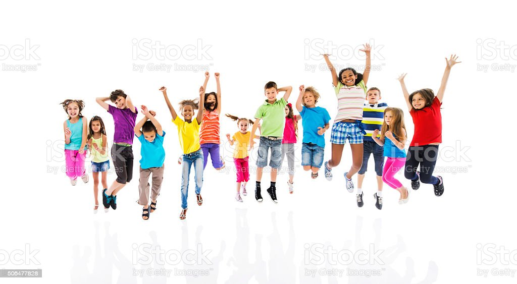 Group of cheerful children jumping with arms raised. stock photo