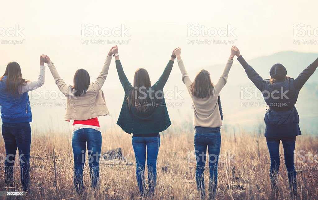 Group of cheerful friends outdoors stock photo