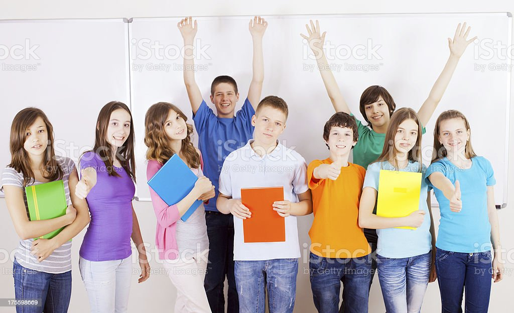 Group of cheerful preteen students next whiteboard. royalty-free stock photo