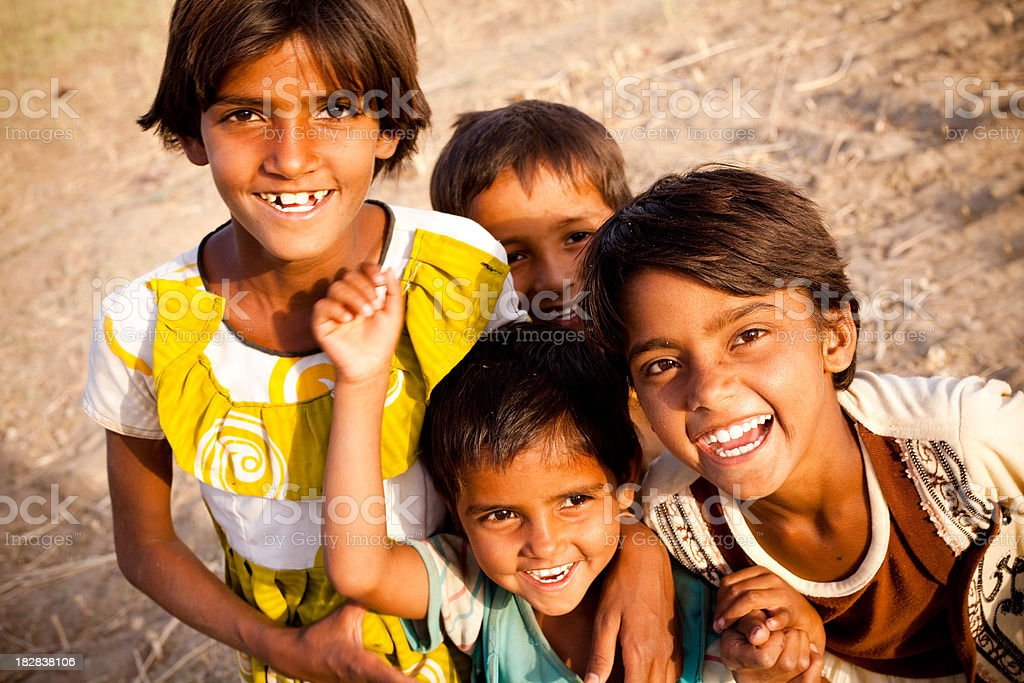 Group of Cheerful Rural Indian Children in Rajasthan stock photo