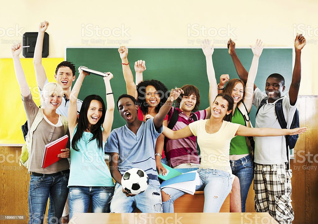 Group of cheerful students looking at the camera royalty-free stock photo