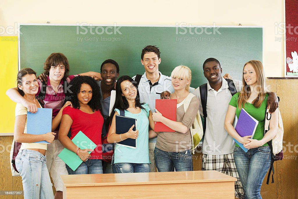 Group of cheerful students looking at the camera. royalty-free stock photo