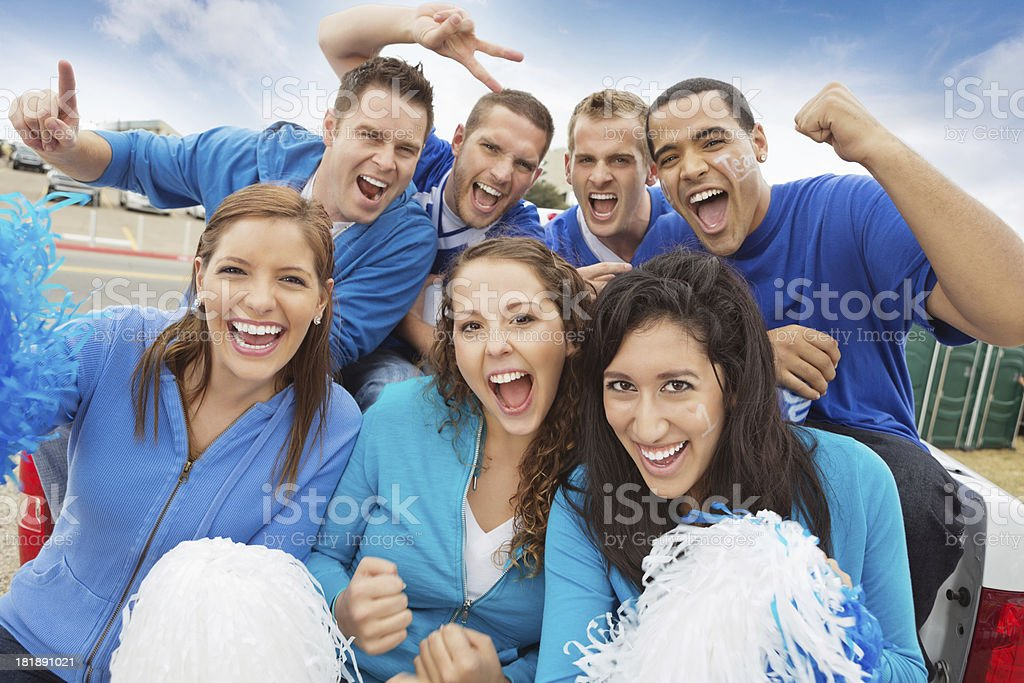 Group of cheering sports fan tailgating at stadium stock photo