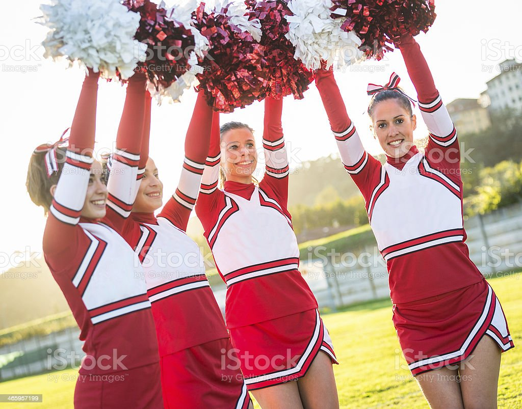 Group of Cheerleaders with Raised Pompom royalty-free stock photo