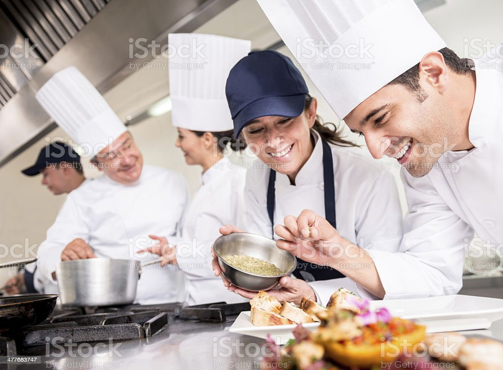 Group of chefs cooking stock photo