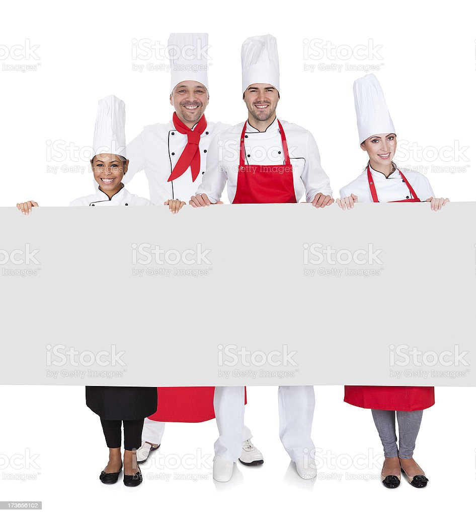 Group of chefs presenting empty banner royalty-free stock photo