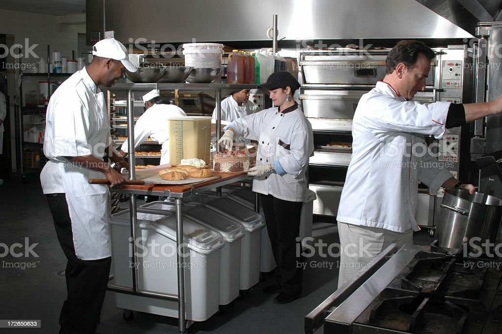 Group of chefs working in kitchen royalty-free stock photo