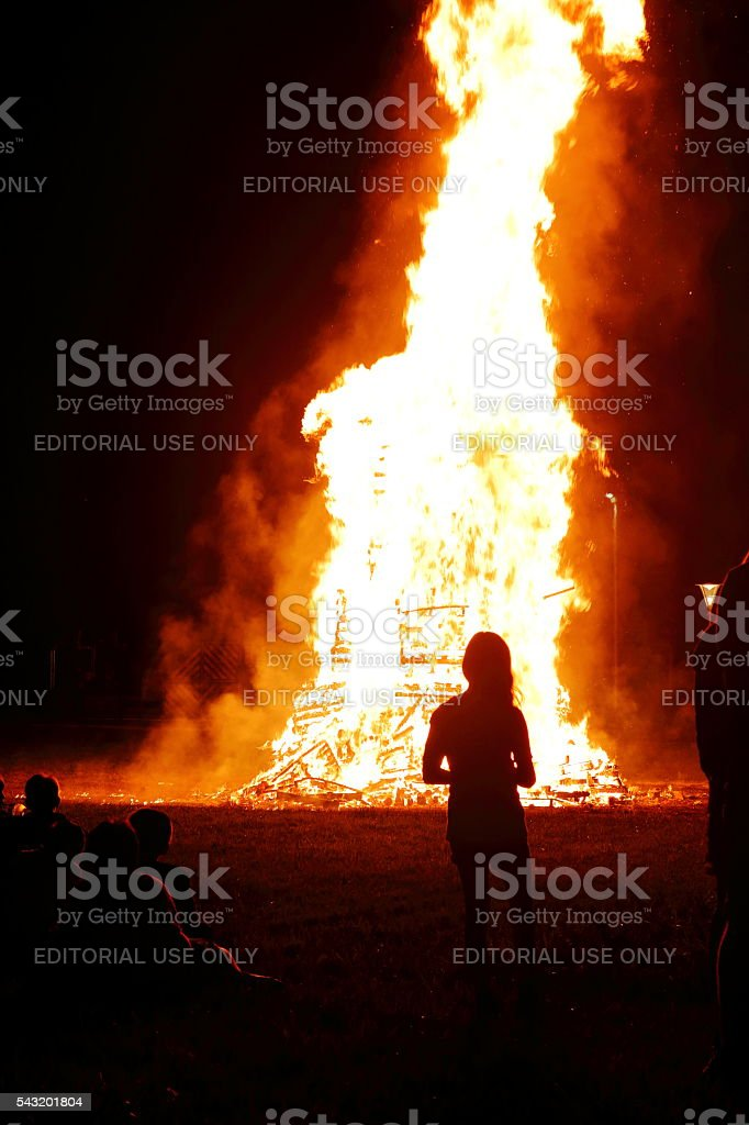 Group of child meeting around big bonfire in summer stock photo