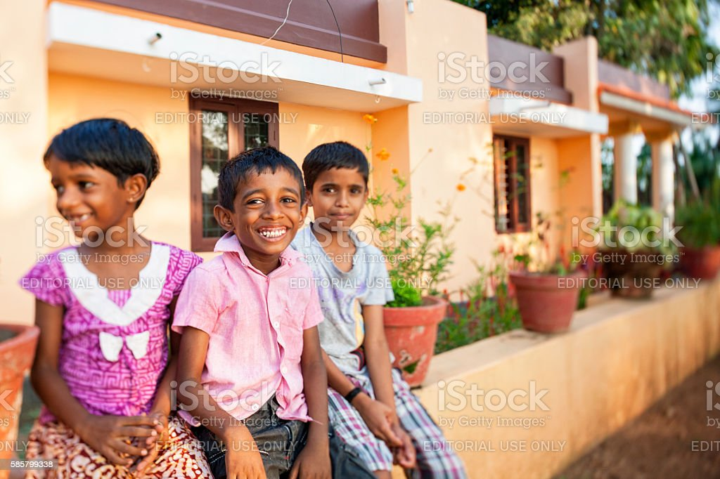 Group of children along the Kerala Backwaters in India stock photo
