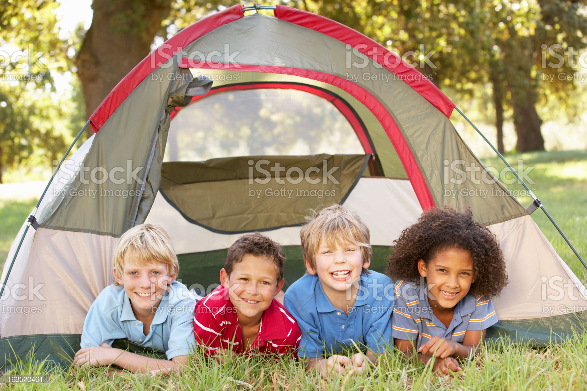 Group of children camping with tent over grass royalty-free stock photo