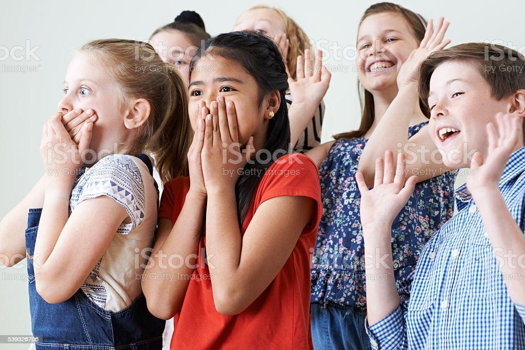 Group Of Children Enjoying Drama Class Together stock photo