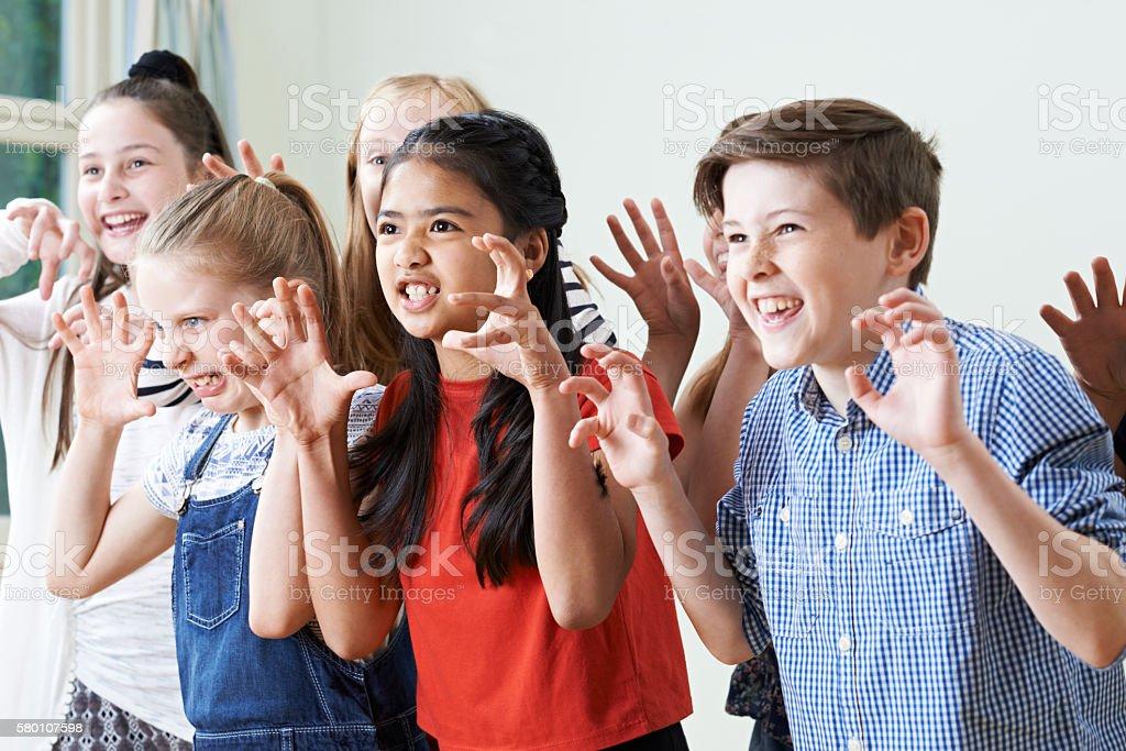 Group Of Children Enjoying Drama Club Together stock photo