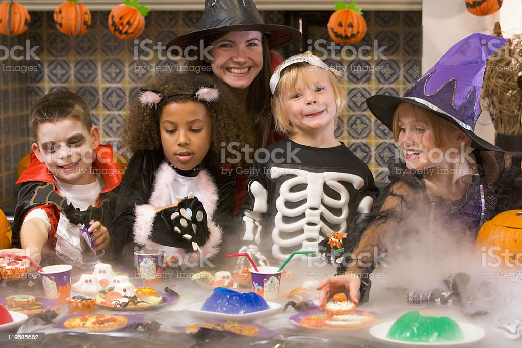 Group of Children Enjoying Halloween Party At Home royalty-free stock photo