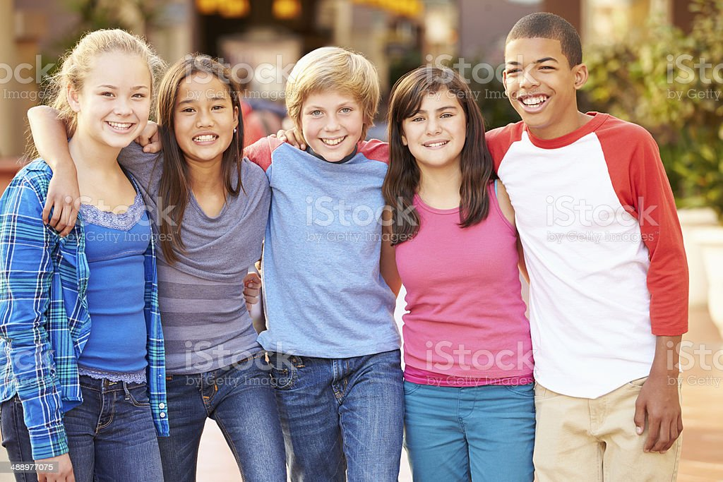 Group Of Children Hanging Out Together In Mall stock photo